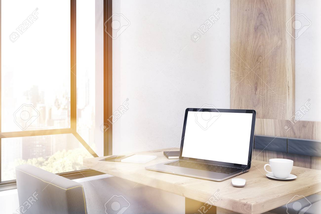 Side View Of Laptop Standing On Cafe Table In Large City Concept - Standing cafe table