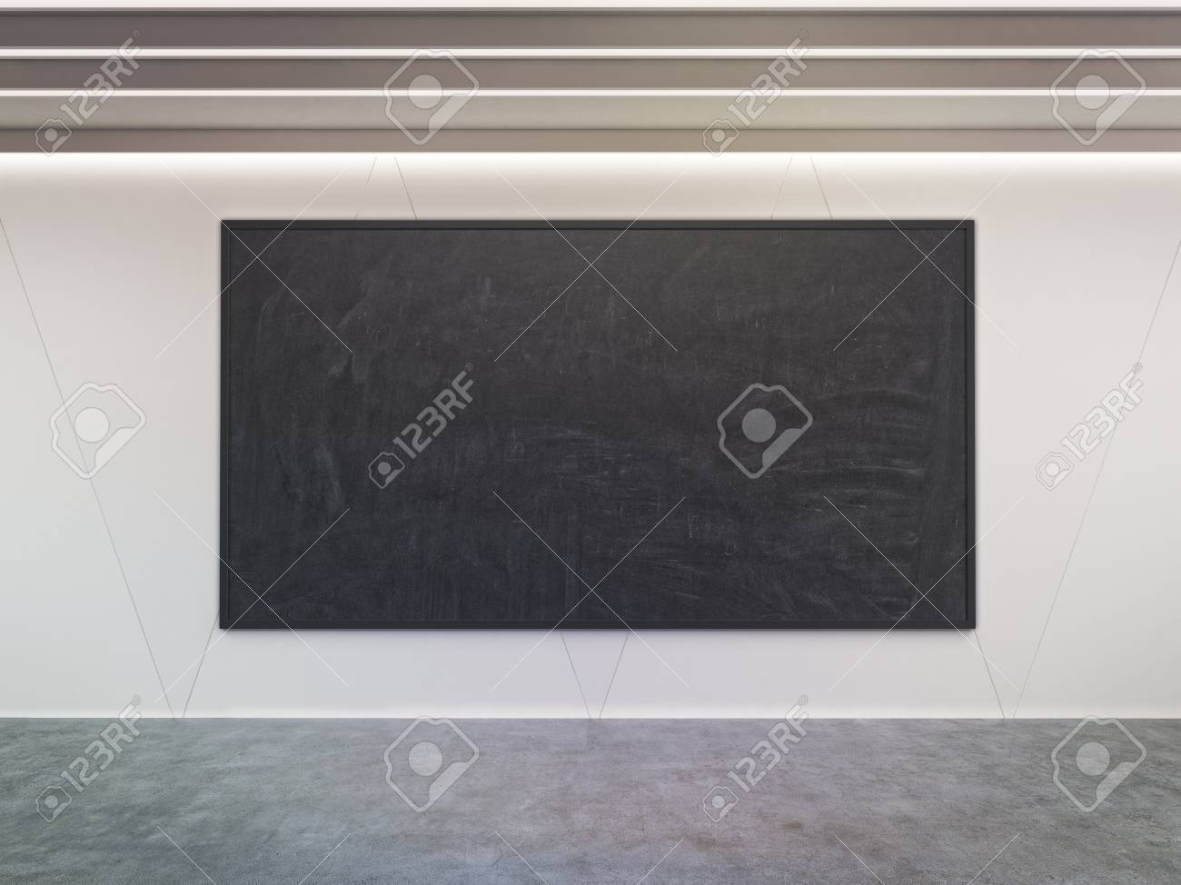 Large Blackboard Hanging In Room With Concrete Walls And Floor