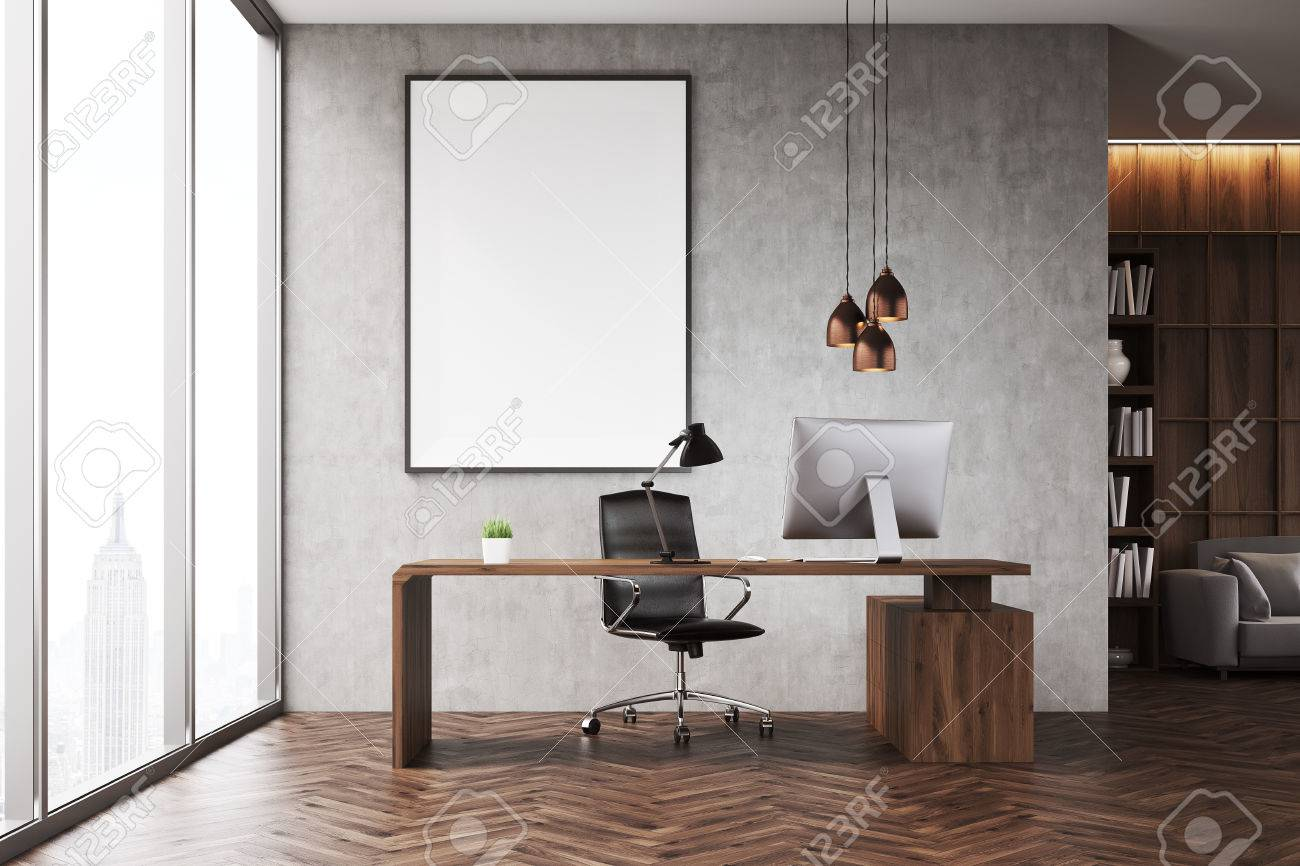 Ceo office with bookcase sofa table and large vertical poster ceo office with bookcase sofa table and large vertical poster on concrete wall geotapseo Gallery
