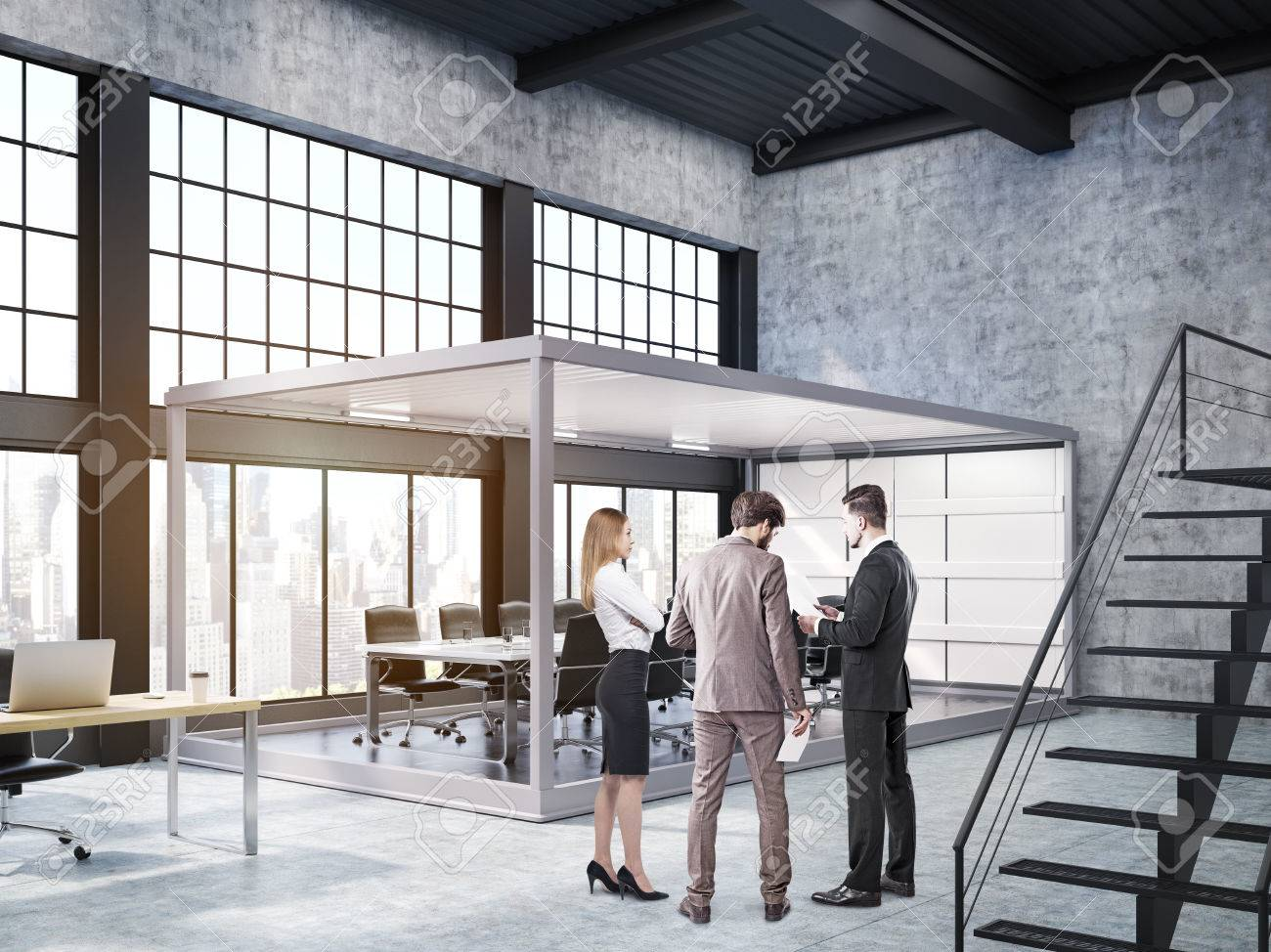 People Are Standing In Open Office With Stairs And Aquarium Board ...