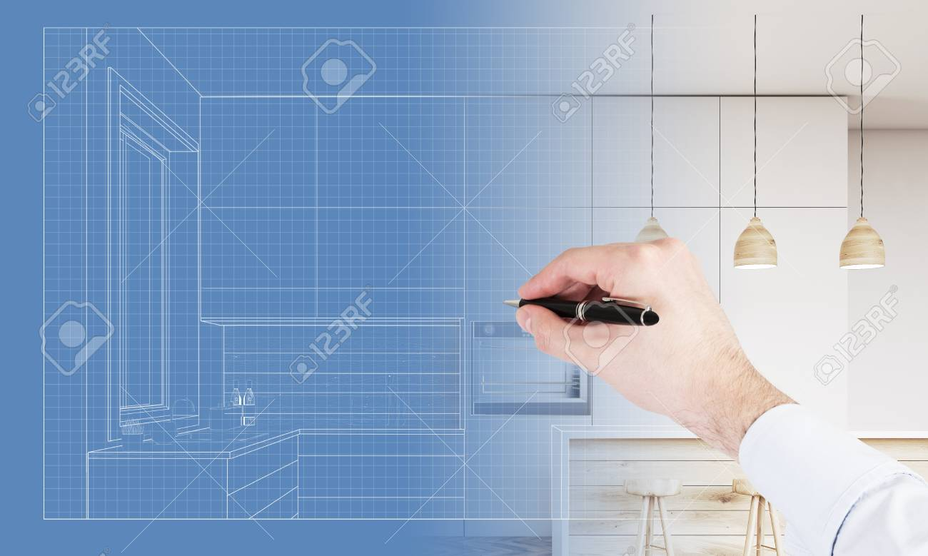 Close Up Of A Hand Drawing A Blueprint Of A Kitchen With Furniture