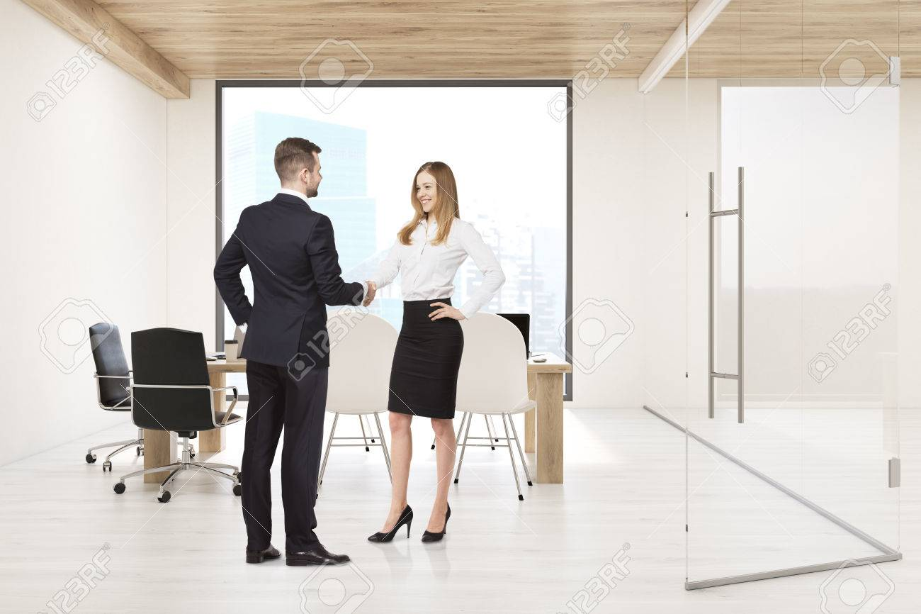 Man And Woman Shaking Hands In Conference Room With Large Square - Large square conference table