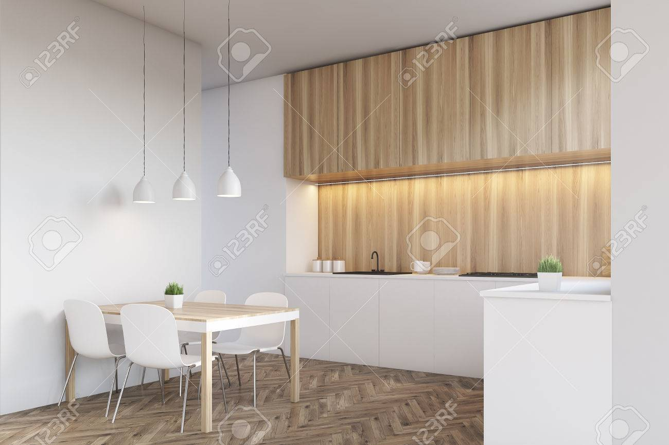 Side view of a kitchen interior with a long counter top and a..