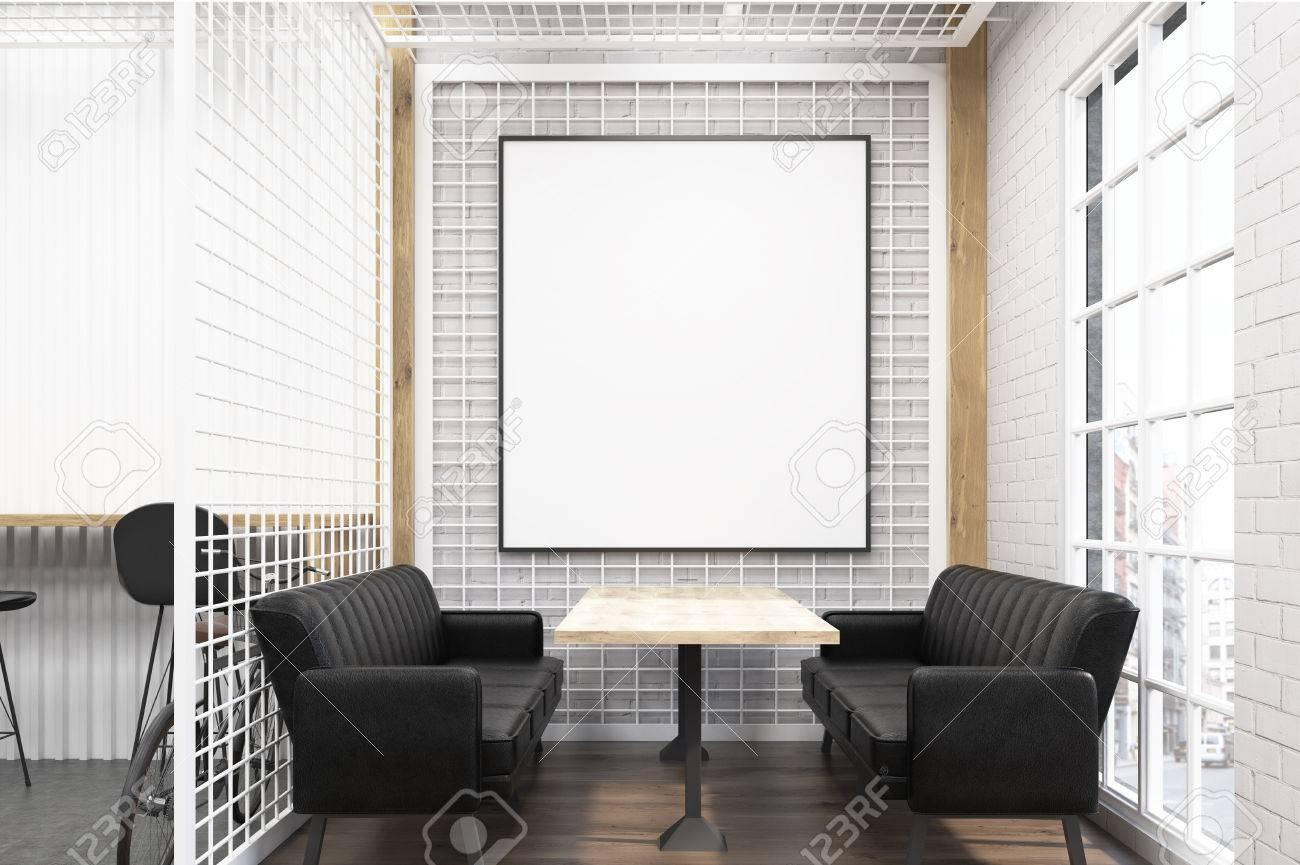 Interior De Café Con Dos Sofás Suaves Y Una Mesa De Madera Y Un Gran ...