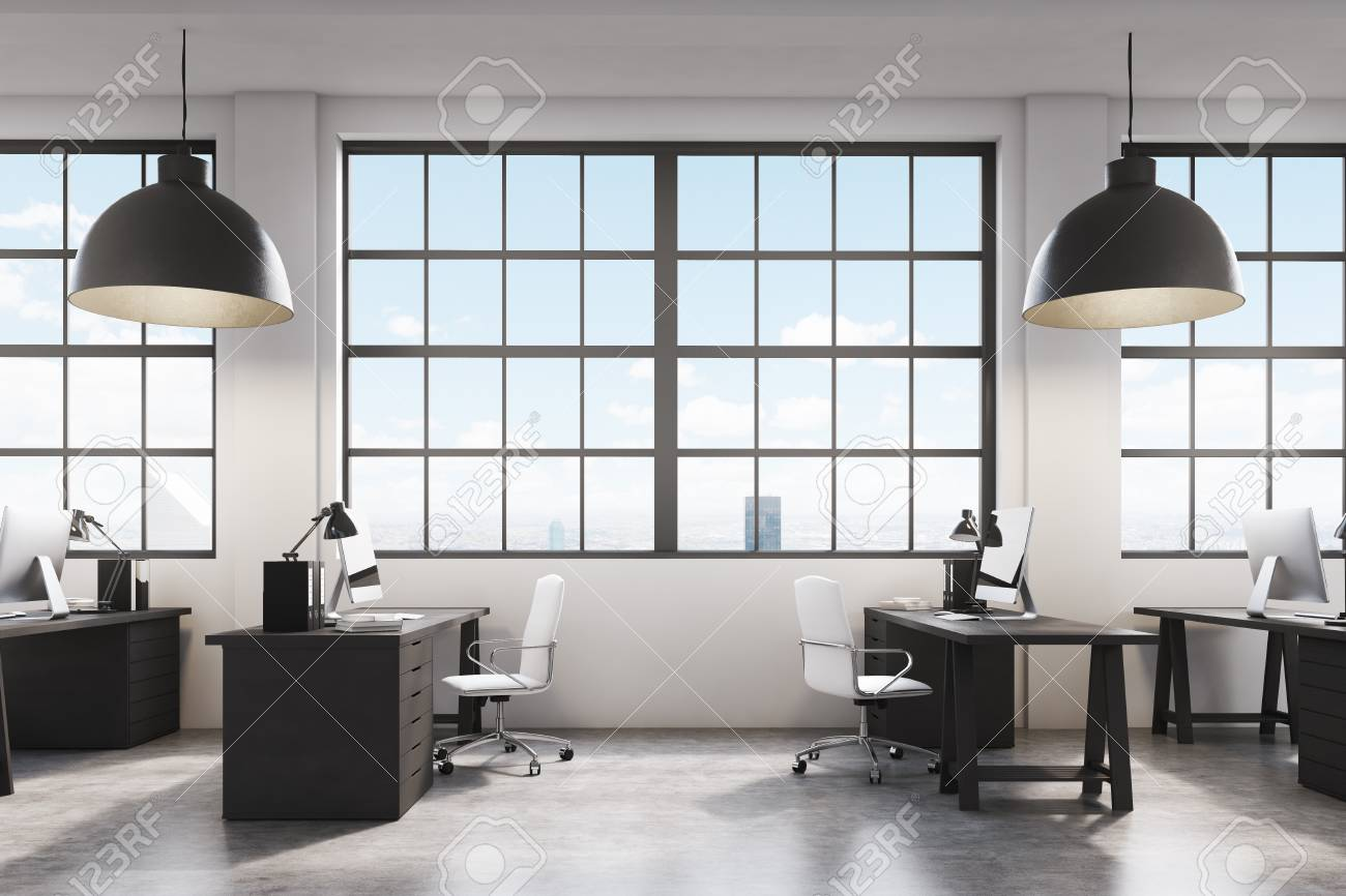 office side tables. Side View Of A Row Tables In An Office. Large Windows With Cityscape. Office