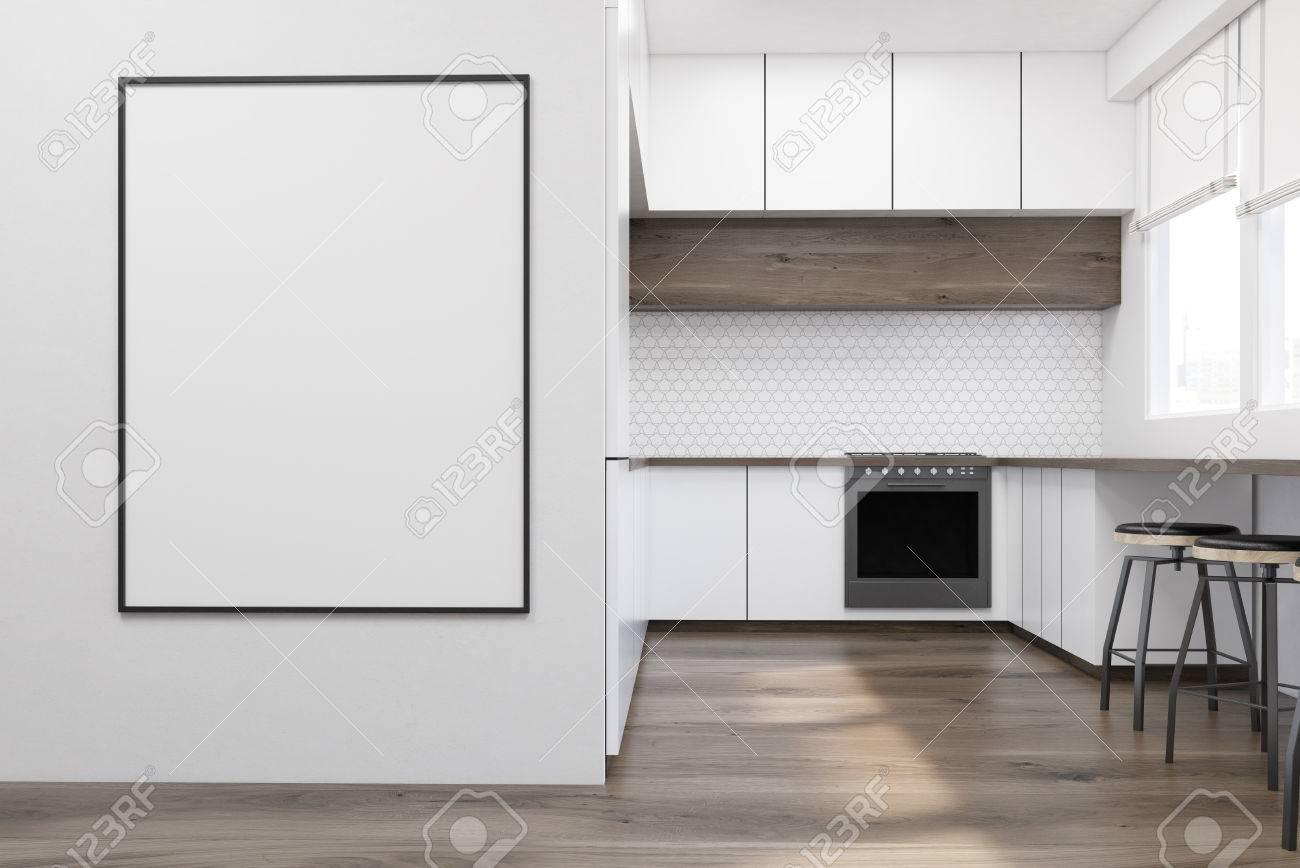 Mobili Tavolo Cucina.Interior Cucina Moderna Con Mobili Bianchi Tavolo In Legno E Un Forno Un Poster Incorniciato E Appeso Su Una Parete Concetto Di Un Appartamento