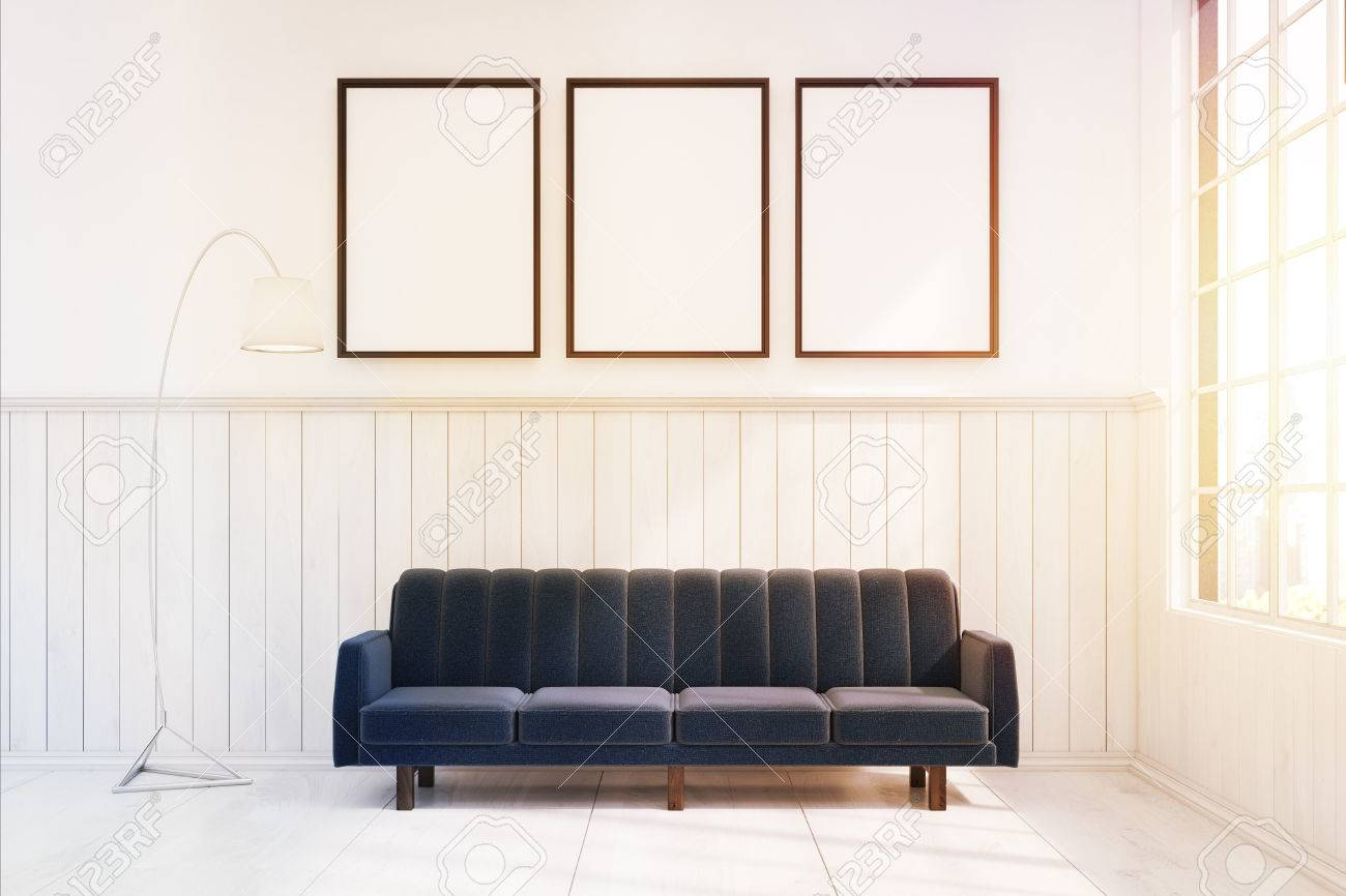 Picture of: Dark Blue Sofa Is Standing In White Room With Wooden And Concrete Stock Photo Picture And Royalty Free Image Image 67059701