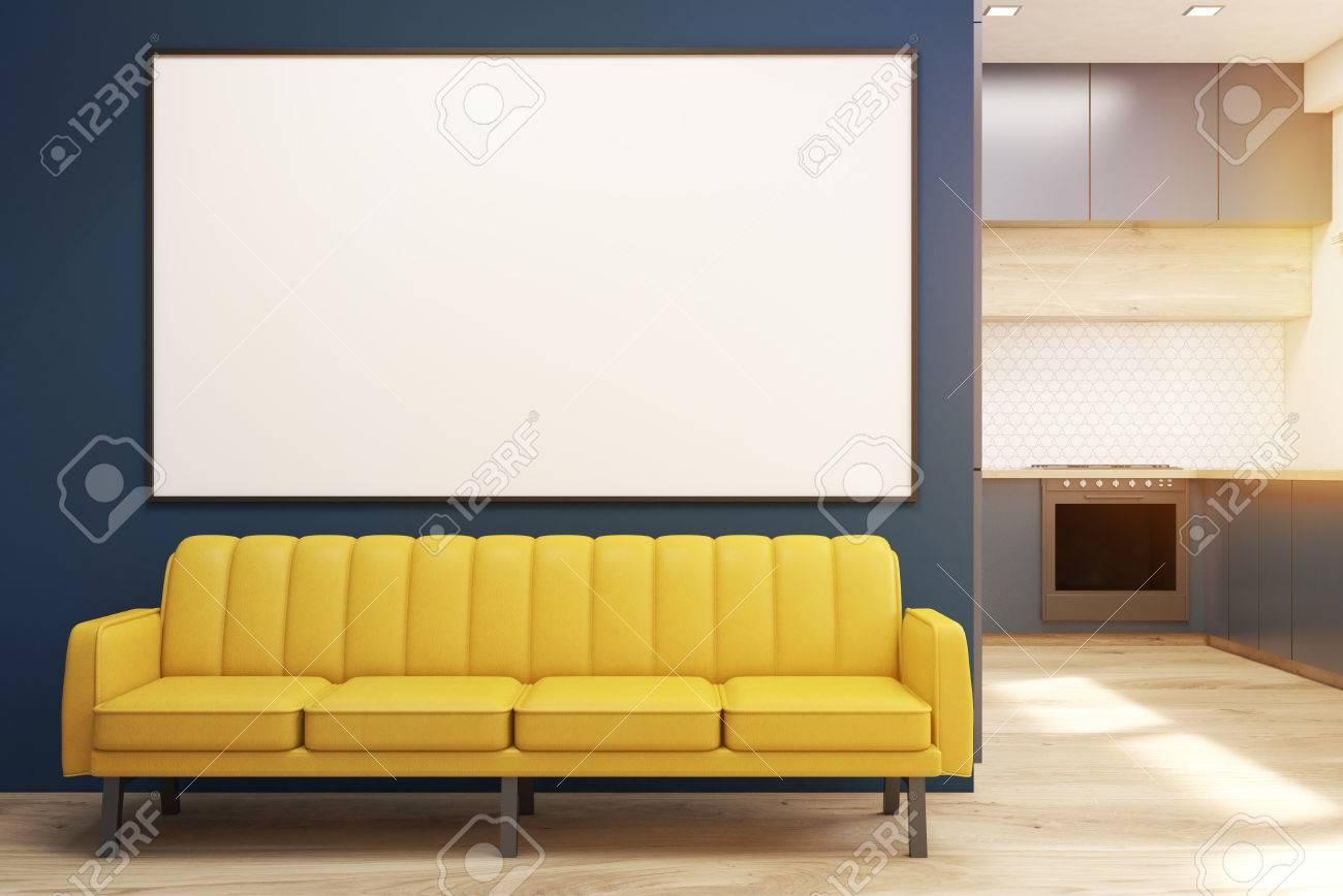 Divano Per Cucina Moderna.Interior Cucina Moderna Con Mobili Blu Tavolo In Legno Un Divano E Un Forno Un Poster Orizzontale E Appeso Su Una Parete Concetto Di Un