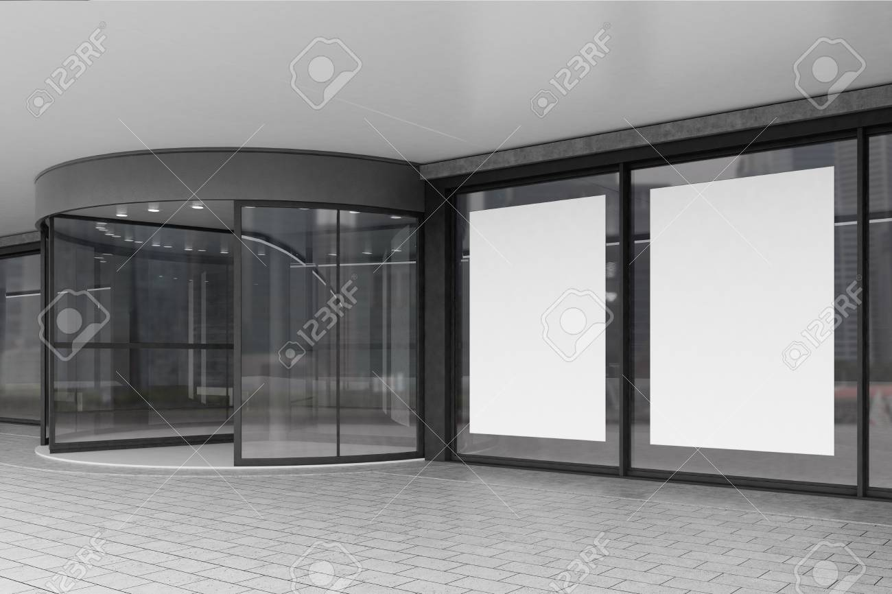 Side View Of A Corporate Building Entrance With A Glass Door Stock