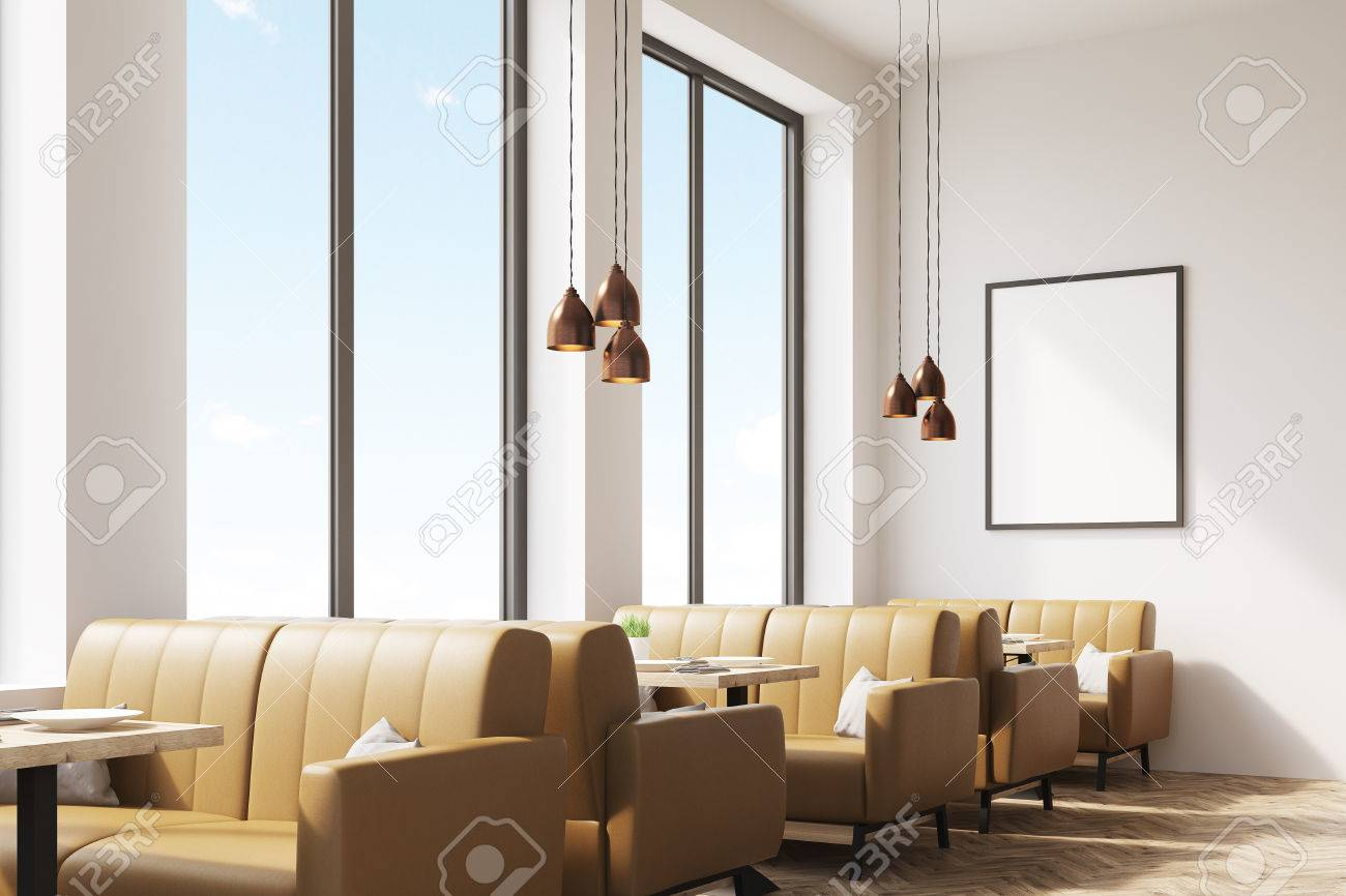 Interior Of A Coffee Shop With Beige Leather Sofas, Large Windows ...