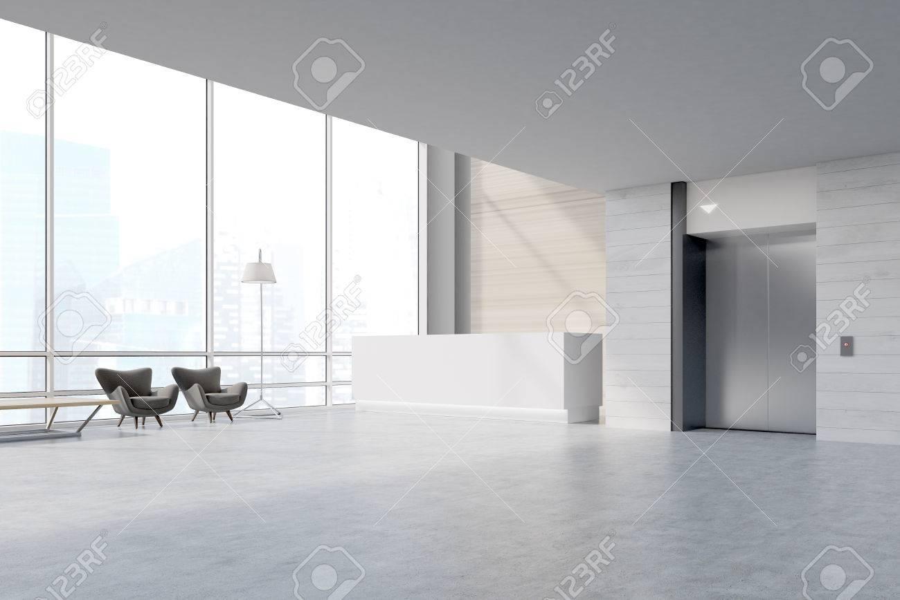 Vue de côté dune zone dattente de bureau avec un bureau de