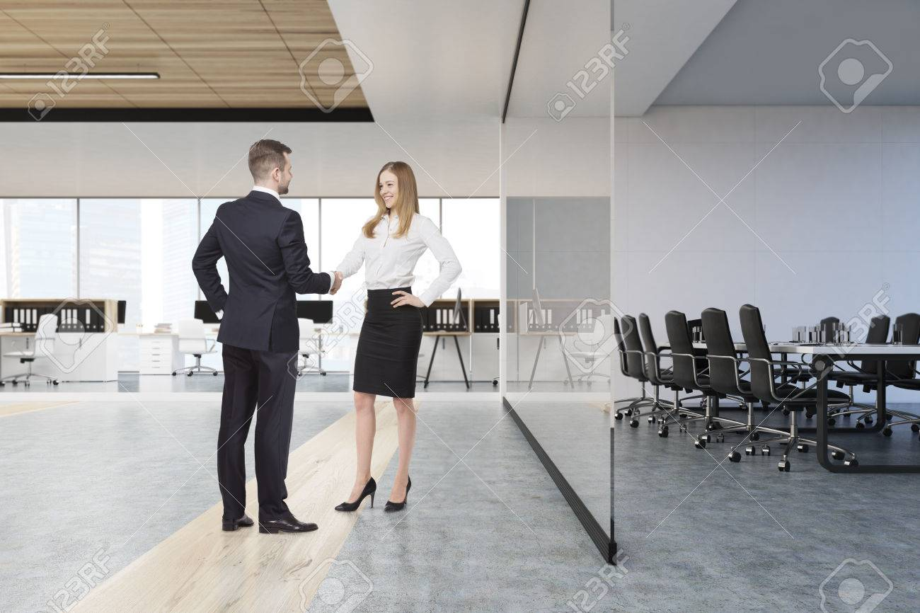 Men And Women In Glass Office The Sun Is Shining Concept Of