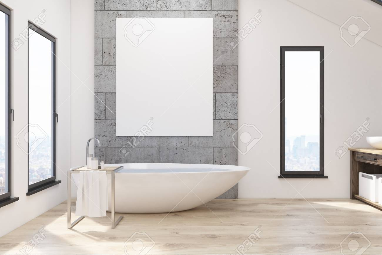 Interior Of A Bathroom With Narrow Windows, White Tub, Concrete ...