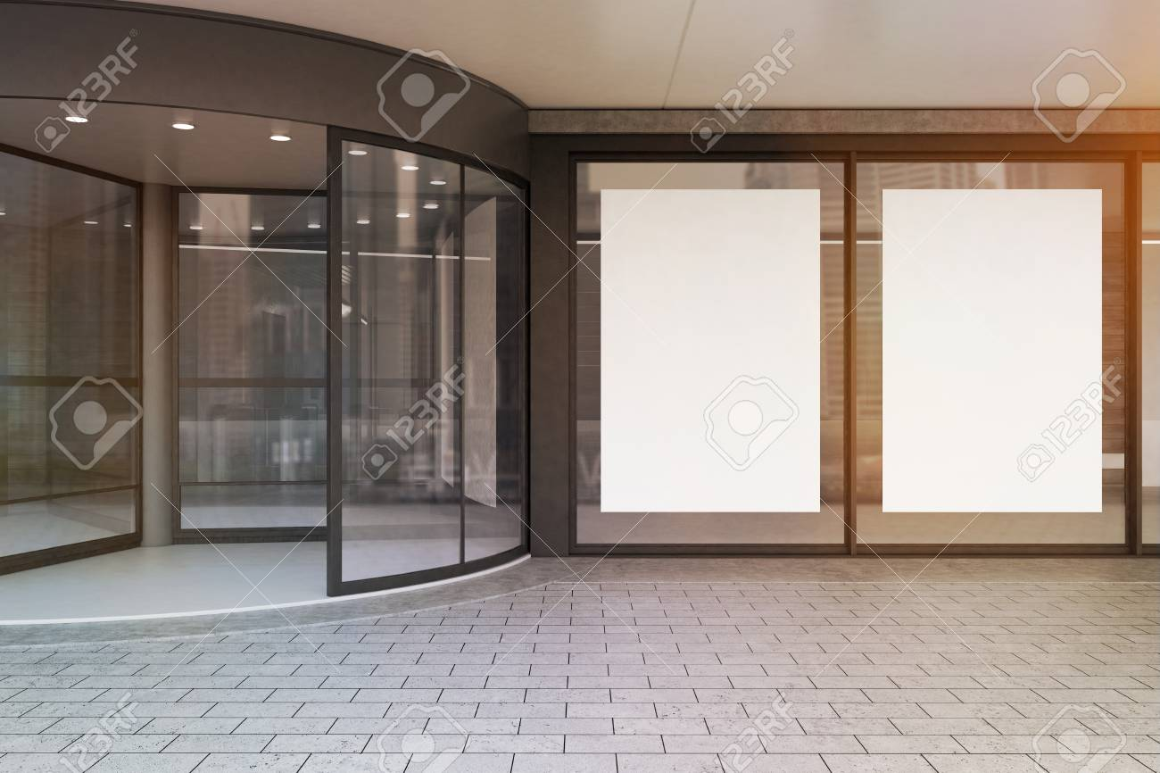 Close Up Of A Corporate Building Entrance With A Glass Door And