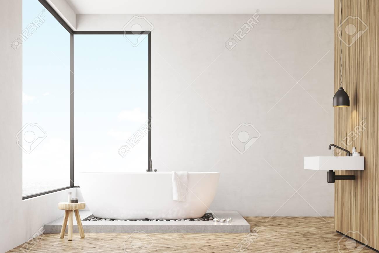 Badezimmer Interieur Mit Einer Holzwand, Weiße Badewanne Mit Einem Handtuch  Und Panoramafenstern. Wiedergabe 3d