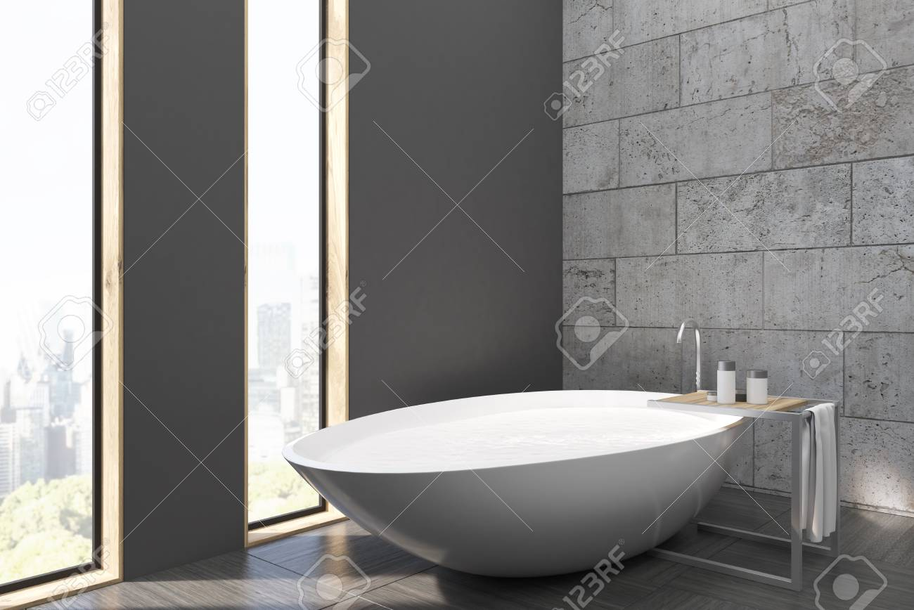 Side View Of A Bathroom With Narrow Windows, White Tub, Concrete ...