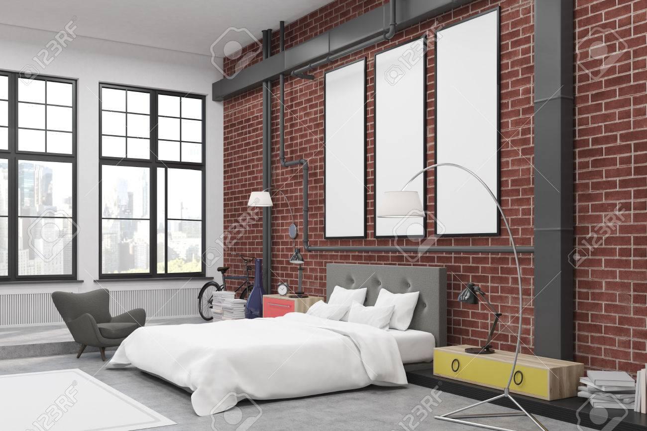 Parete Colorata Camera Da Letto angolo della camera da letto con pareti di mattoni e tre stretti poster  verticali su di loro. c'è un grande letto, una poltrona, due lampade e