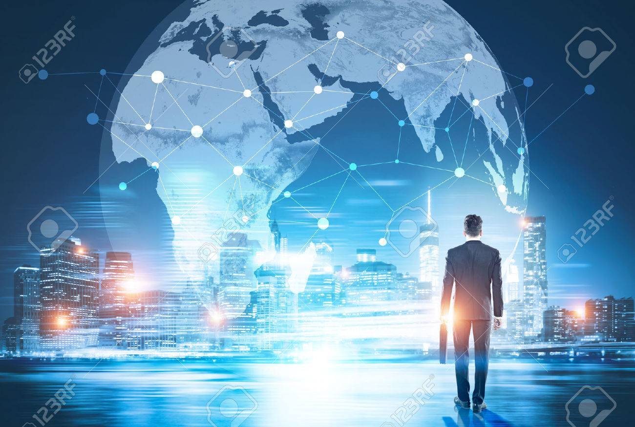 Back view of businessman in night city looking at globe with network. Global networking and international business concept - 70384747