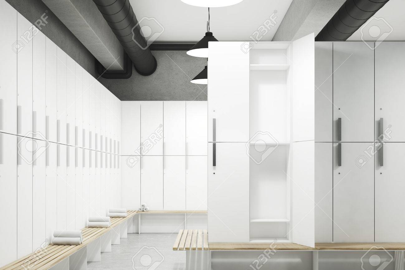 Locker Room With Gray Walls, A Row Of Wooden Storage Lockers Near The Wall  And
