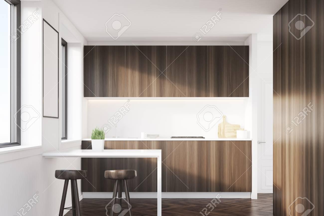 Intérieur De Cuisine En Bois Sombre Avec Une Table Deux Tabourets Et Des Comptoirs Grandes Fenêtres Avec Une Affiche Suspendue Entre Eux Rendu