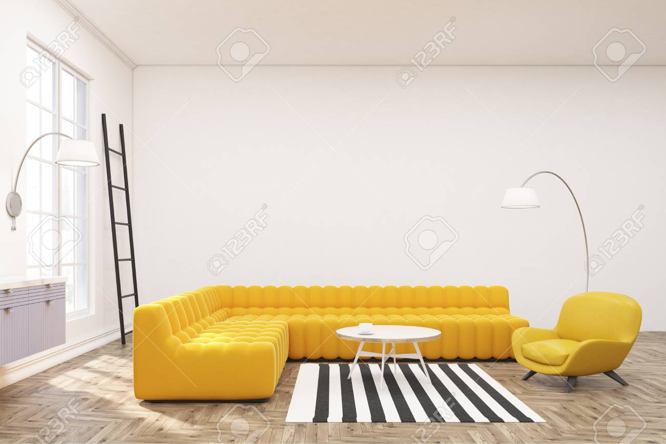 Side view of a modern spacious lounge interior with yellow sofas,..