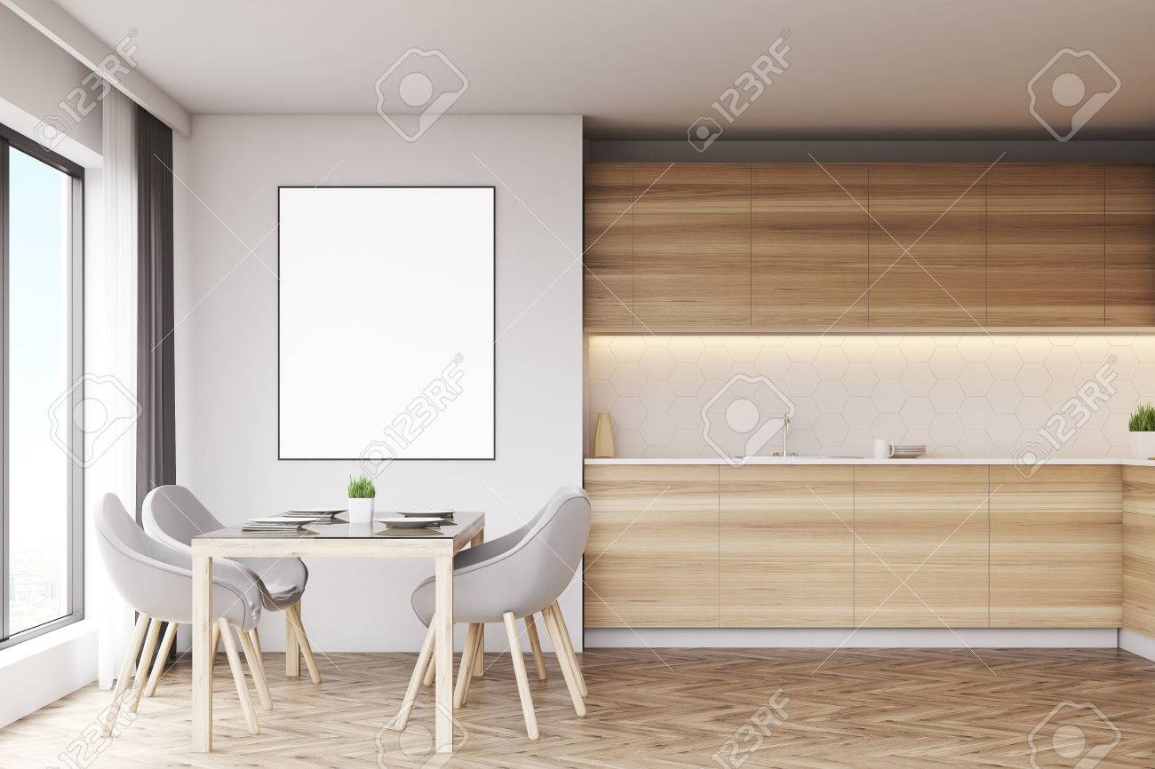 Light Wood Kitchen With A Table And A Poster. There Are Countertops ...
