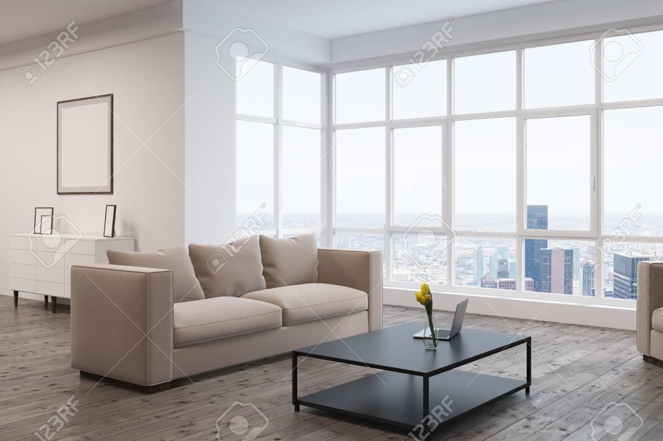 Standard Bild   Wohnzimmerinnenraum Mit Einem Großen Beige Sofa, Einem  Kaffeetisch, Einem Bild Auf Einer Wand Und Einem Panoramischen Fenster.  3D Rendering.