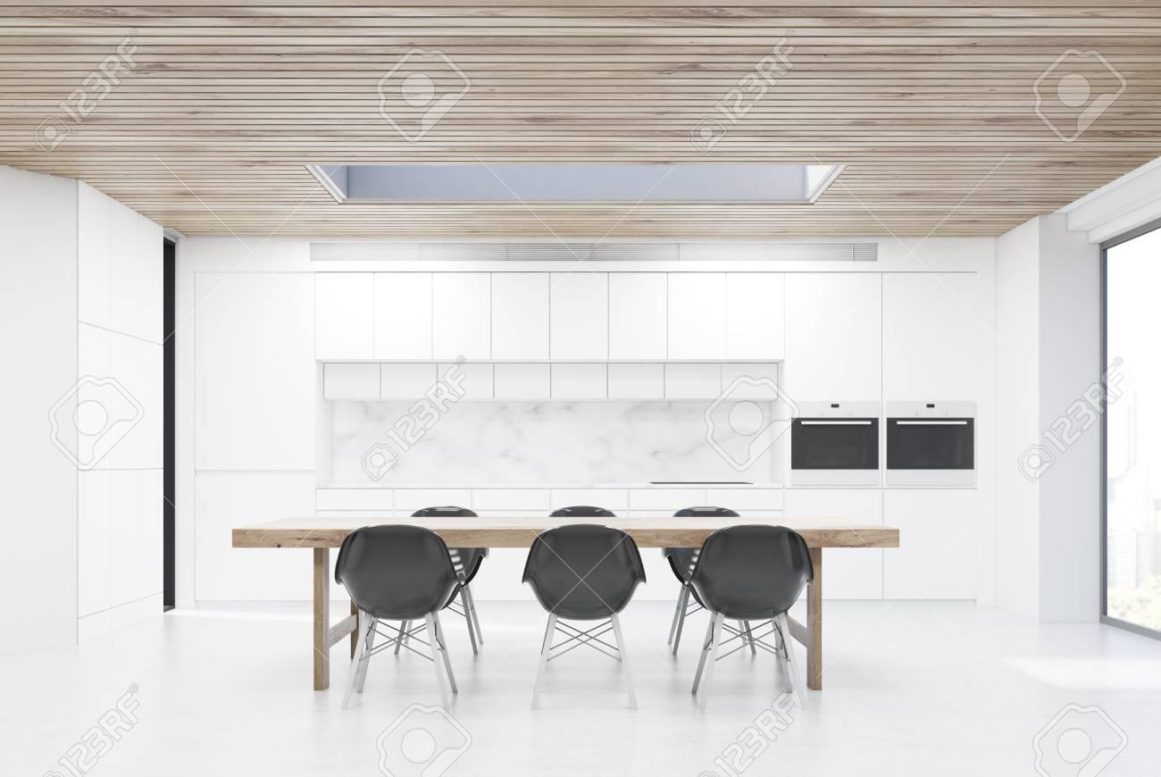 Cucina con un lungo tavolo e sei sedie nere. C\'è un contatore bianco sullo  sfondo. Rendering 3D