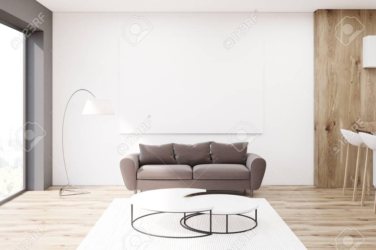 Standard Bild   Wohnzimmer Mit Einem Braunen Sofa, Das Nahe Einem Weißen  Kaffeetisch Steht. An Der Wand Hängt Ein Horizontales Plakat. 3D Rendering.