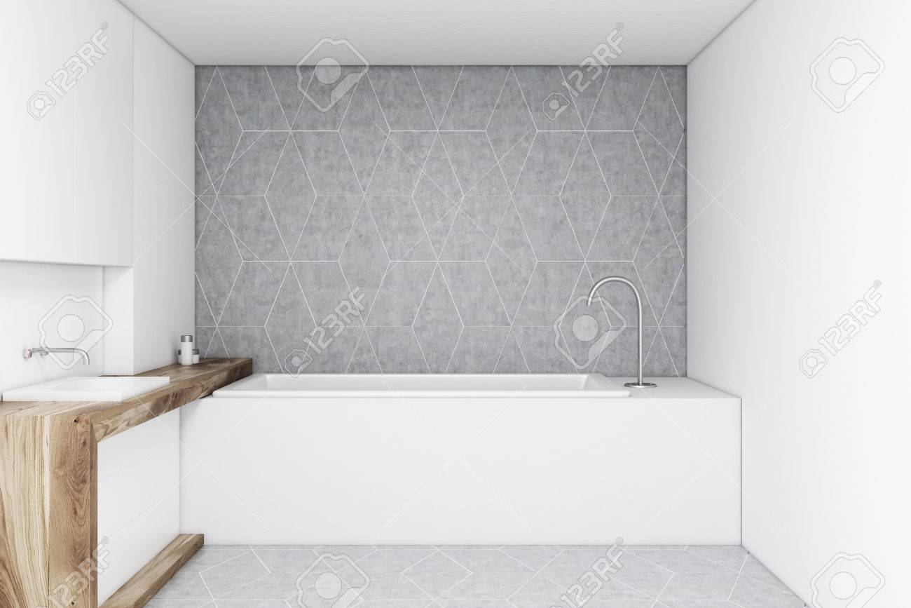 Bathroom With A Gray Wall, A Wooden Sink And A Rectangular Bathtub ...