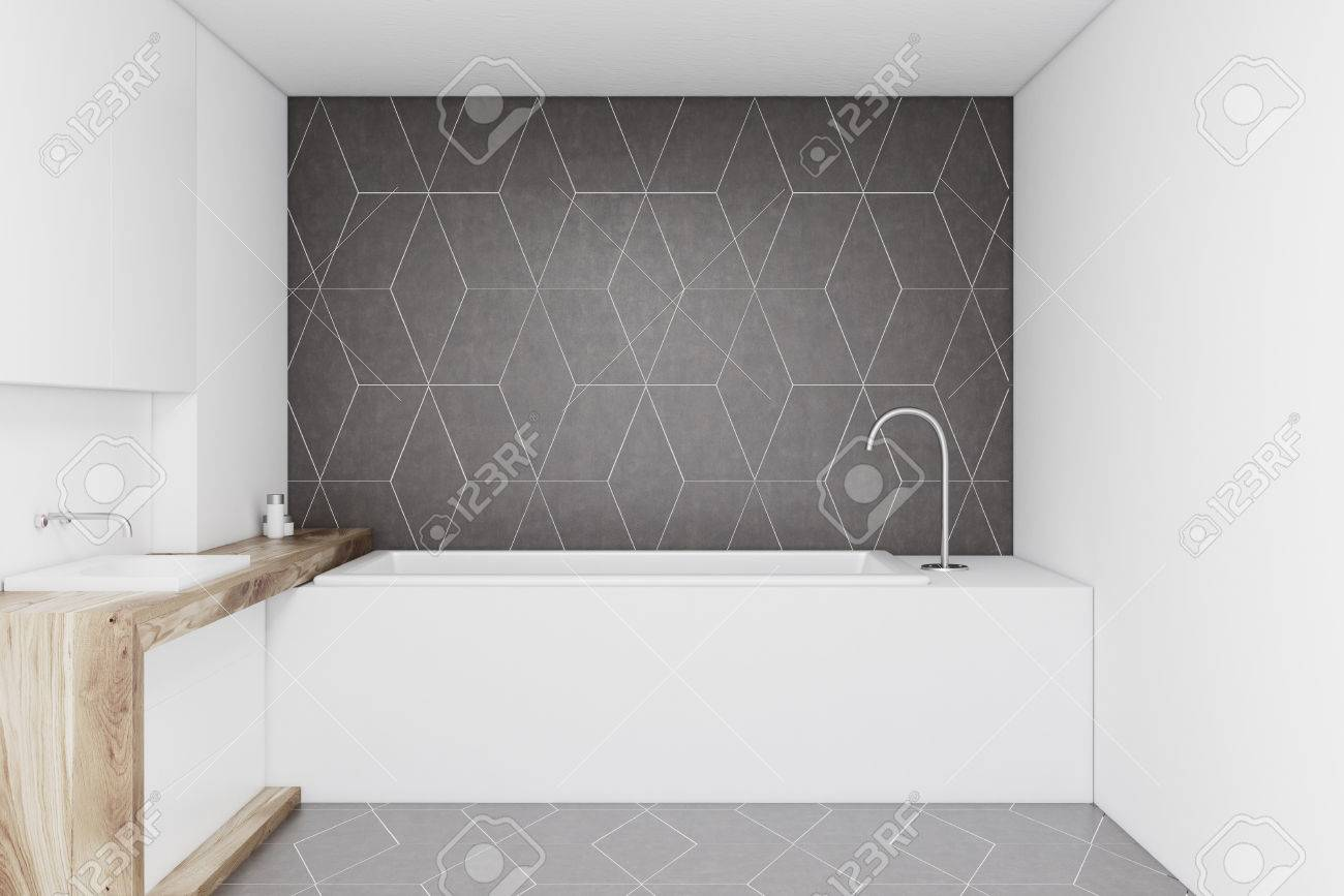 Bathroom With A Dark Gray Wall, A Wooden Sink And A Rectangular ...