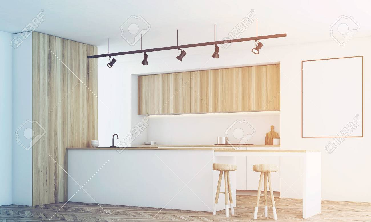 Cucina Legno E Bianco side view of a white kitchen with a bar and light wooden furniture