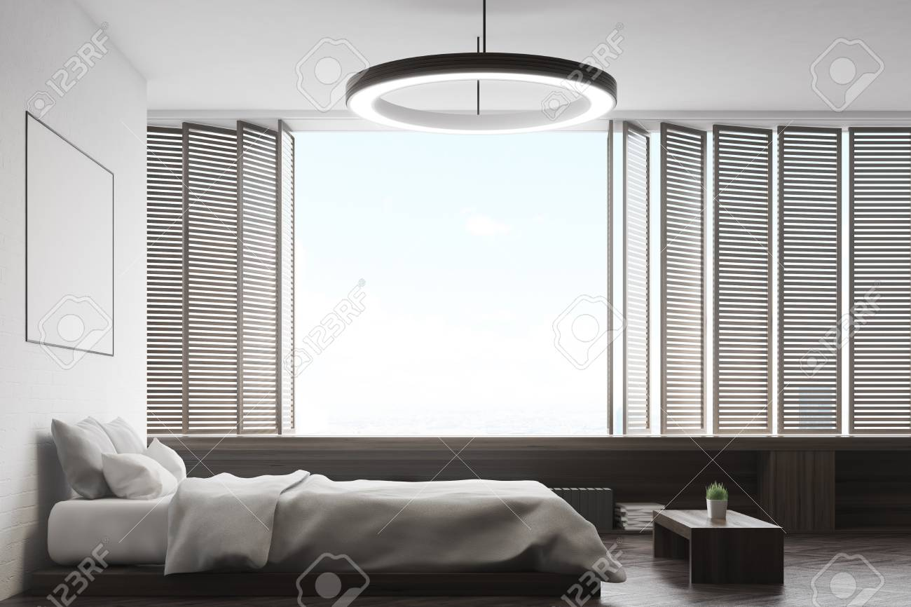 Vista laterale di una camera da letto con un grande letto, una finestra  panoramica, una panca e un poster sopra il letto. Rendering 3D, mock up