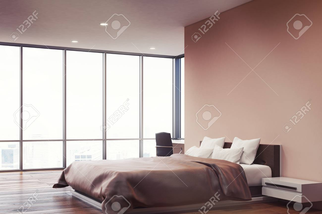 Side View Of A Bedroom With Pink Walls, A Double Bed With Two ...