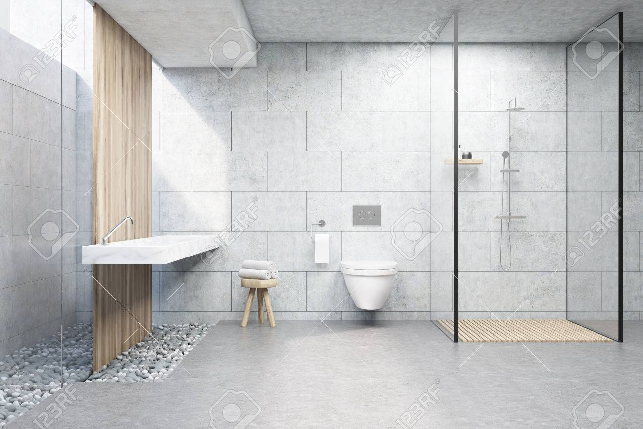 Bathroom Interior With Gray Brick Walls, A Shower Cabin With Glass Wall, A  Toilet