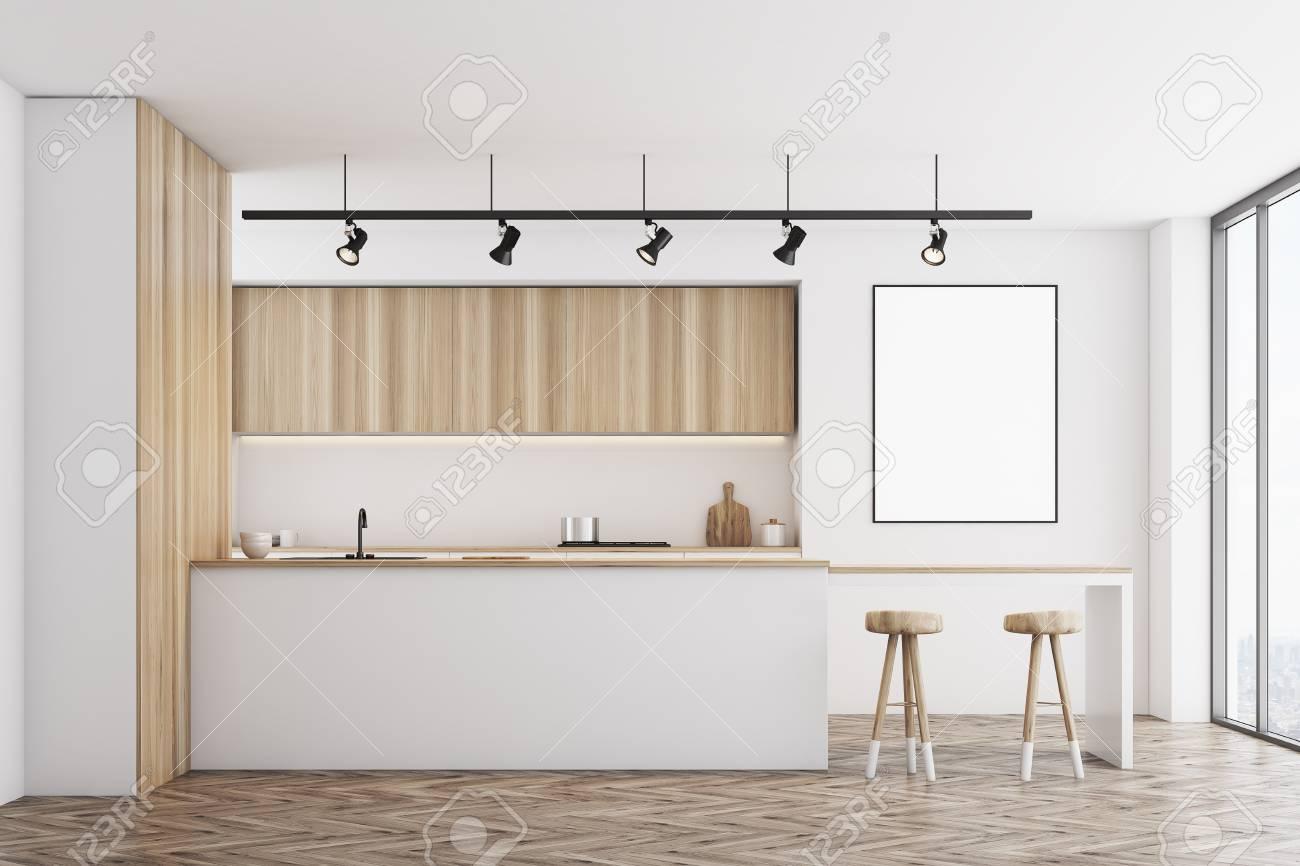 Vista frontale di una cucina bianca con un bar e mobili in legno chiaro.  C\'è un poster incorniciato vuoto su un muro. Rendering 3D, mock up