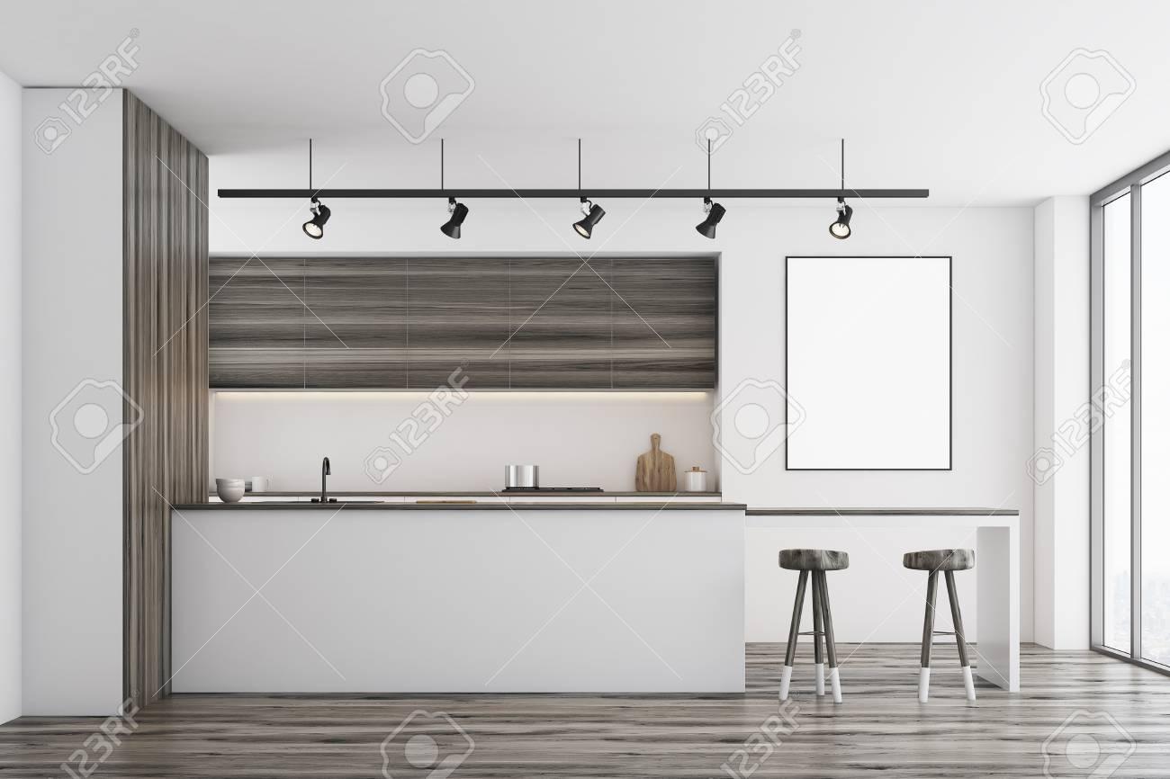 Vista frontale di una cucina bianca con un bar e mobili in legno scuro. C\'è  un poster incorniciato vuoto su un muro. Rendering 3D, mock up