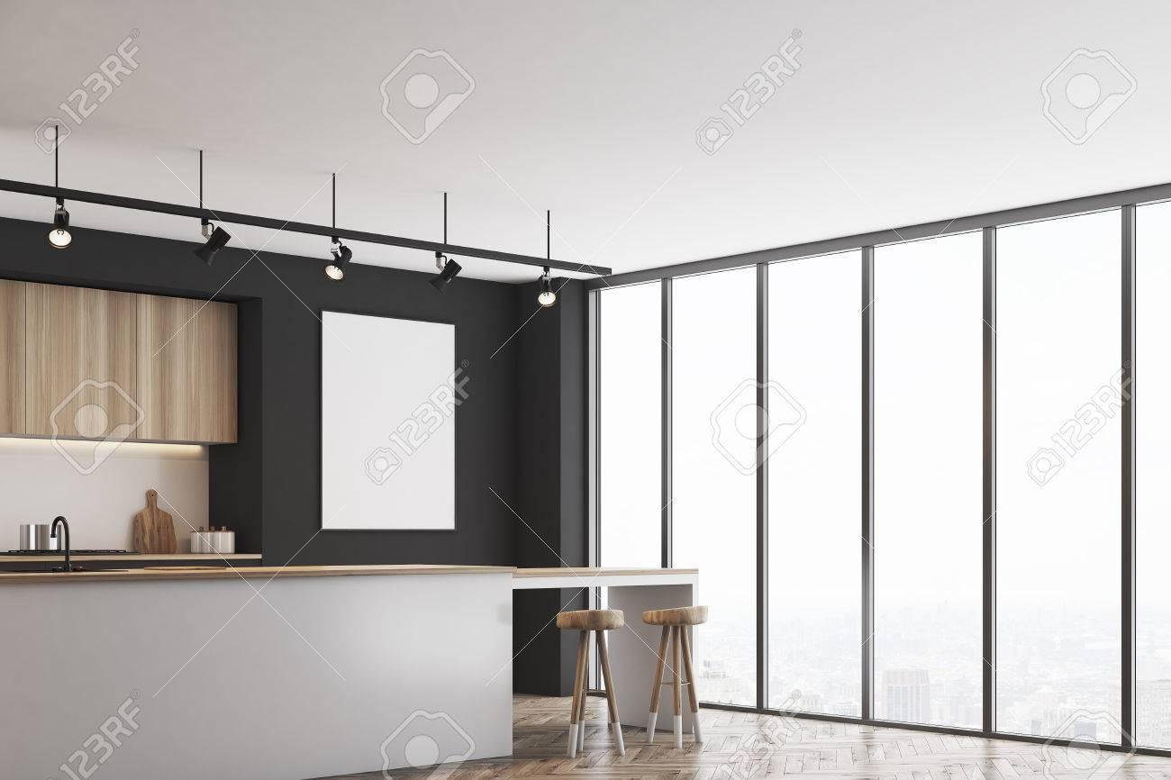 Angolo di una cucina nera con un bar e mobili in legno chiaro. C\'è un  manifesto incorniciato in bianco su un muro. Rendering 3D, mock up