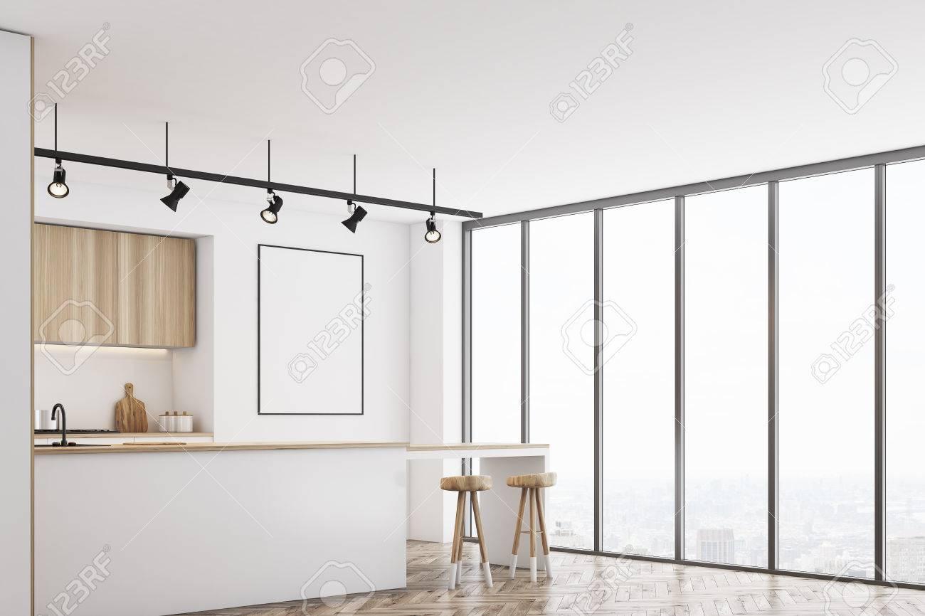 Angolo di una cucina bianca con un bar e mobili in legno chiaro. C\'è un  manifesto incorniciato in bianco su un muro. Rendering 3D, mock up