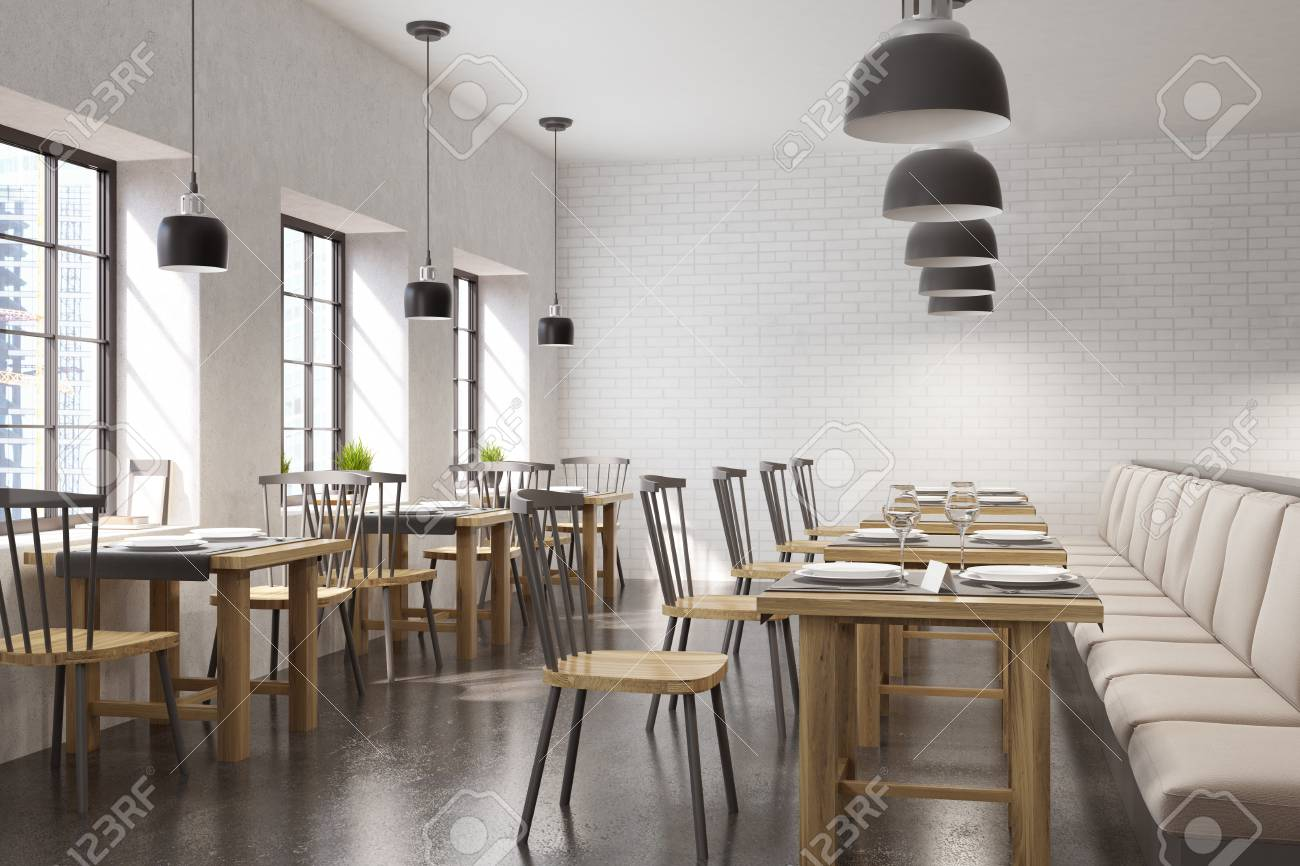 Cafe Interior With Square Tables, Beige Sofas And Chairs. Row Of Windows In  The