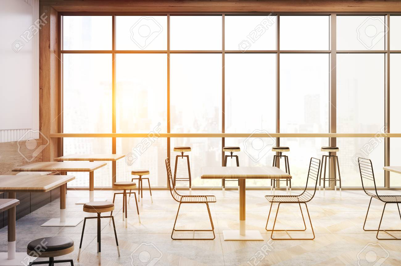 Cafe Interior With Panoramic Windows, Square Wooden Tables, Transparent  Chairs And Bar Stools.