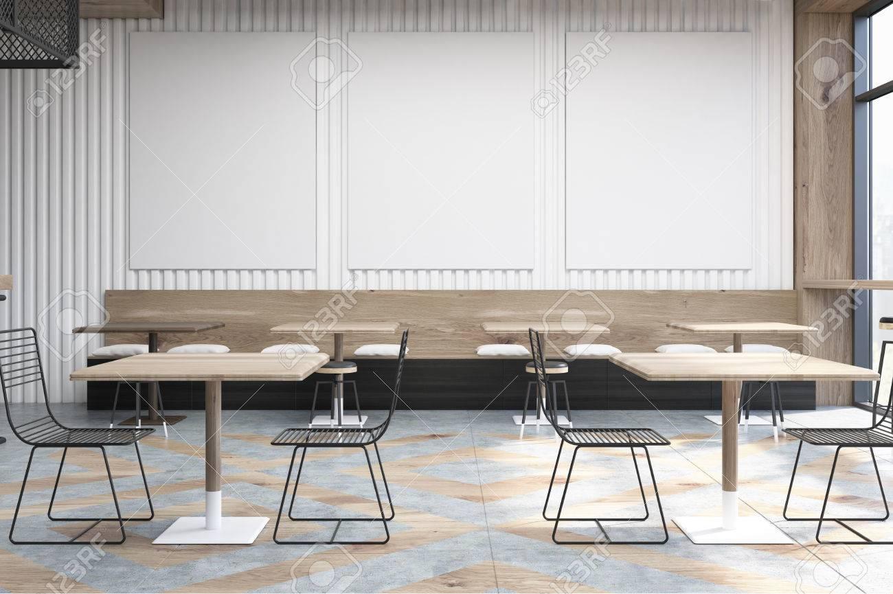 Tavolo Legno E Sedie Trasparenti.Interni Di Caffe Con Tavoli Quadrati In Legno Sedie Trasparenti Divani Con Cuscini E Tre Poster Verticali Appesi A Un Muro Rendering 3d Mock Up