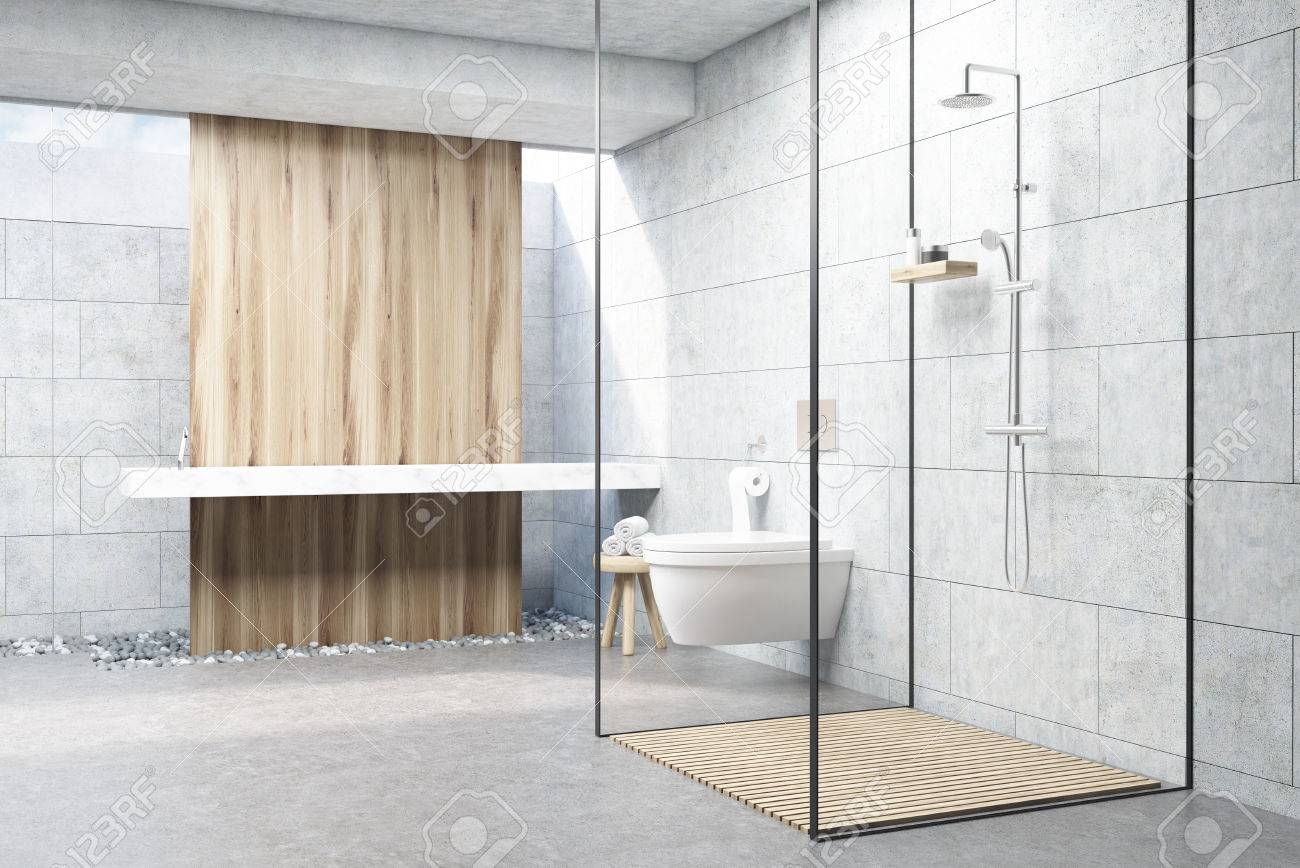 Gray Bathroom Interior With A Wooden Panel, A Shower With Glass Walls, A  Double