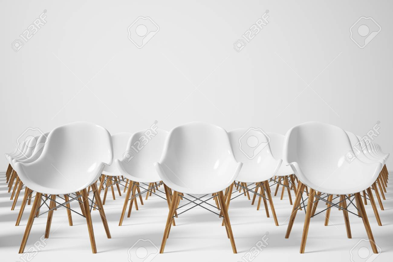 Front View Of Rows Of White Chairs Standing In An Auditorium On A White  Floor Near