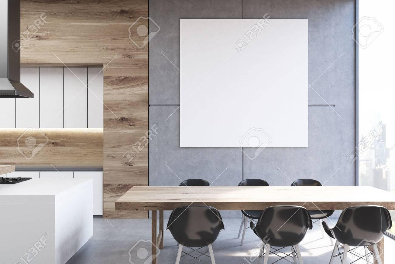 Interni in cucina con un lungo tavolo, sedie nere in piedi in prossimità e  un poster quadrato appeso su un muro grigio. Rendering 3D, mock up