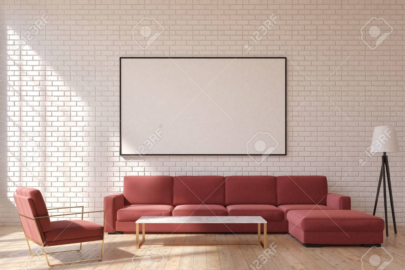 Front view of a living room with brick walls, a red sofa and..