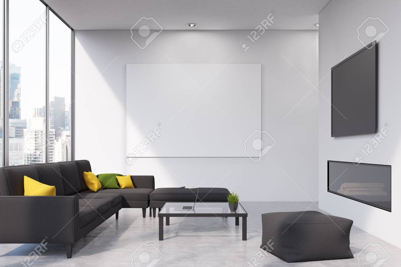 Front View Of A Living Room With A Black Sofa, A Fireplace And ...