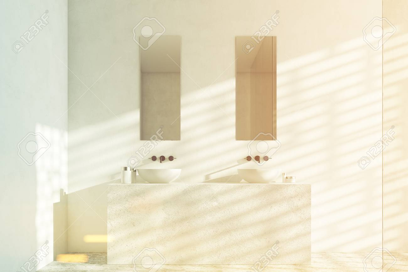 Front View Of A Bathroom With Two White Sinks And Narrow Rectangular ...