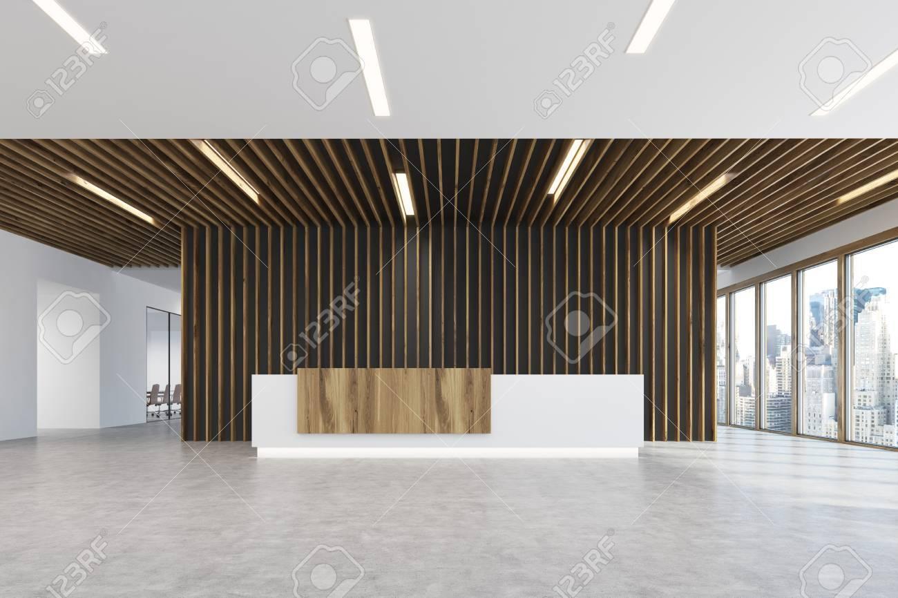 白と光の木製受付カウンターは木...