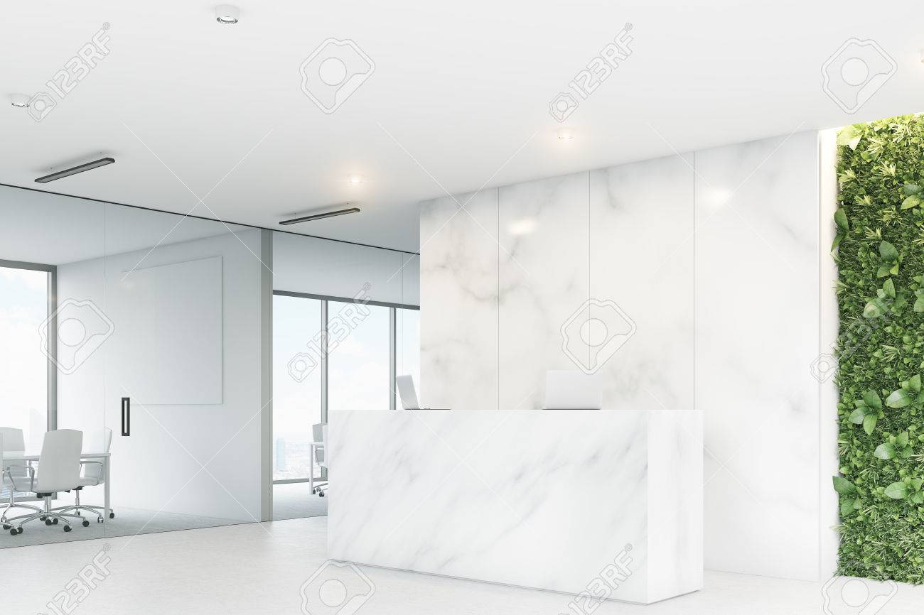 office wall desk. Corner Of A White Reception Desk With Two Laptops Standing On It In Front Office Wall M